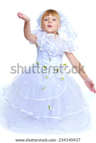Preparing for Christmas, holiday, baby joy concept .Little girl dressed as a white princess.Isolated on white background.