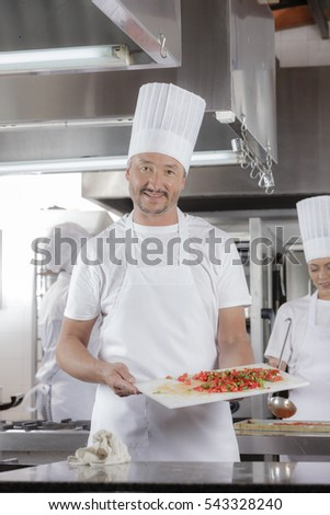 Preparing for lunch or dinner session in an professional industrial restaurant kitchen and presenting chopped vegetables