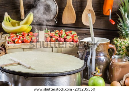 Preparing for pancakes with fruit and chocolate