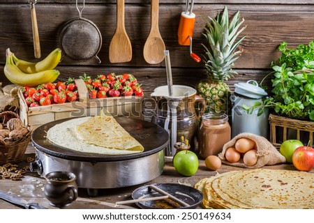 Preparing for pancakes with fruit and chocolate - stock photo