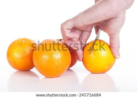 Preparing fresh orange juice squeezed with juicer - stock photo