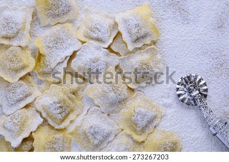 Preparing fresh ravioli at the kitchen table.