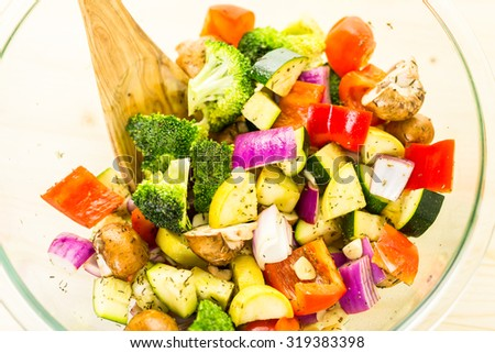Preparing fresh roasted mixed vegetables for dinner.
