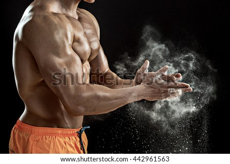 Preparing hands for lifting weights