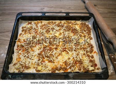 Preparing Homemade Pizza - stock photo