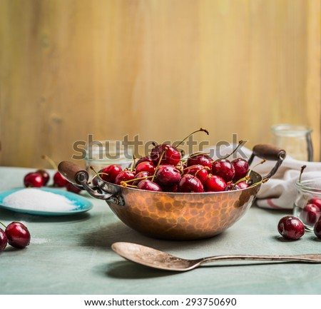 preparing of Sweet cherry preserve,  homemade jam or  jelly on rustic kitchen background - stock photo