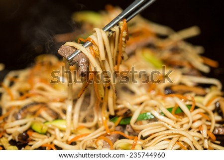 Preparing pad thai at a street hawker mobile restaurant in Bangkok, Thailand. Fried noodle. Shallow dof.  - stock photo
