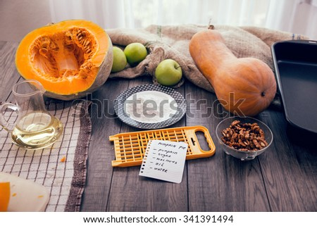 Preparing pie with pumpkins on wooden table