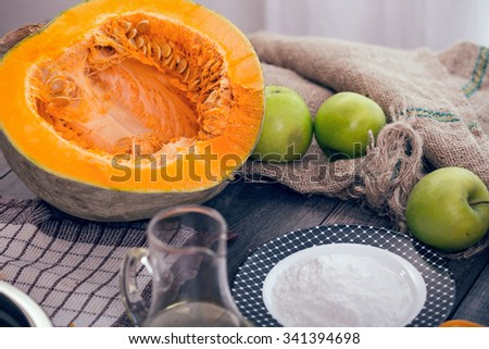Preparing pie with pumpkins on wooden table, selective focus - stock photo