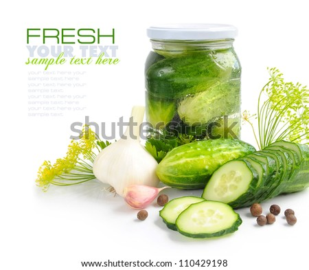 Preparing preserves of pickled cucumbers in jar with spices and herbs - stock photo