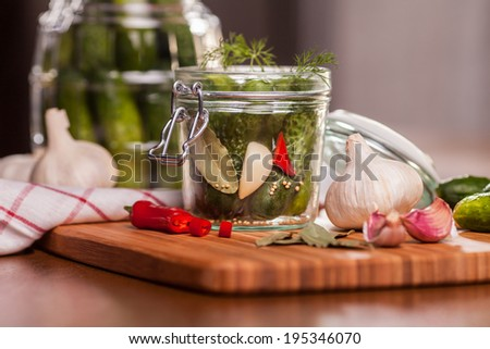 Preparing sour cucumbers in the kitchen - stock photo
