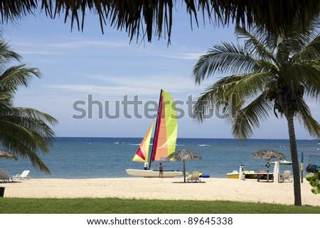 Preparing the catamaran. Cuban Caribbean - stock photo
