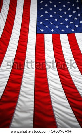 Preparing the flag and getting ready to fold the flag. - stock photo