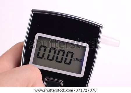 Preparing to take a breathalyser test - stock photo