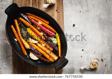 preparing vegan meal: colorful carrots and potatoes ready for the oven. Top view.