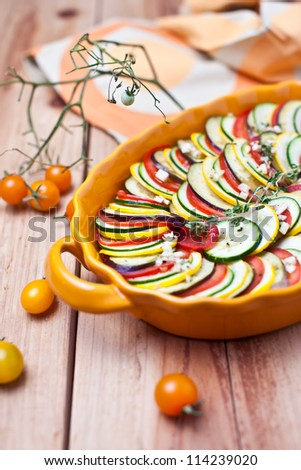 Preparing vegetable gratin on a wooden background - stock photo