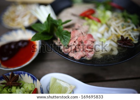 Preparing Vietnamese rice noodles, with beef and other materials