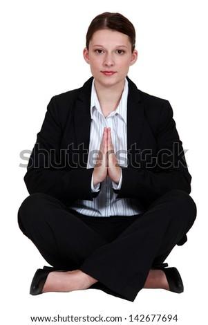 preppy woman in lotus position - stock photo