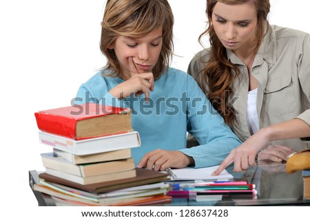 Prepubescent boy being tutored - stock photo