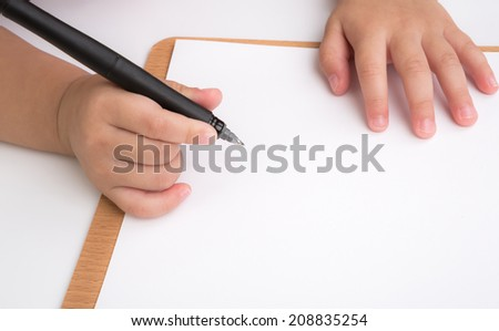 Preschool age child writing - stock photo