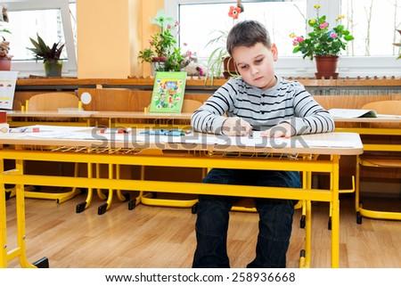 Preschool boy doing enrollment to school - stock photo