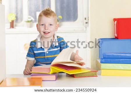 Preschool Boy With Colourful Books - stock photo