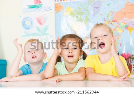 Preschool children with hands up - stock photo