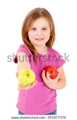 Preschool girl holding apple - stock photo