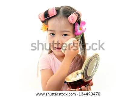 Preschool girl playing with makeup
