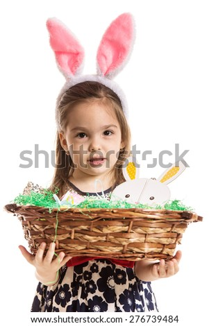Preschool girl with bunny ears holding basket with easter eggs isolated on white background - stock photo