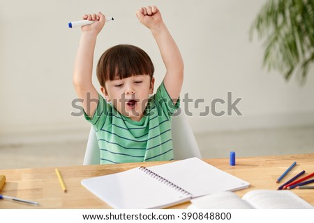 Preschool kid drawing pictures at home - stock photo