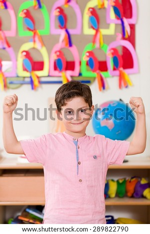 Preschooler boy posing at camera. - stock photo