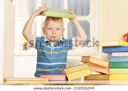 Preschooler Boy With Colourful Books