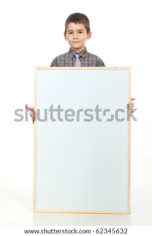 Preschooler boy with soft smile holding a blank paper placard - stock photo