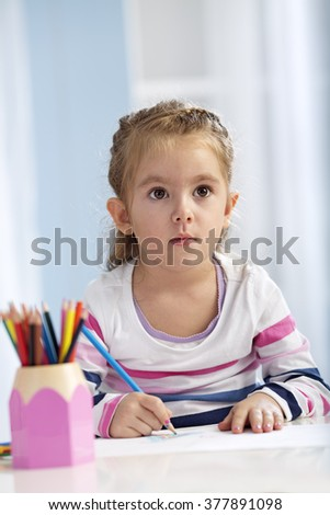 Preschooler listening to the teacher with attention