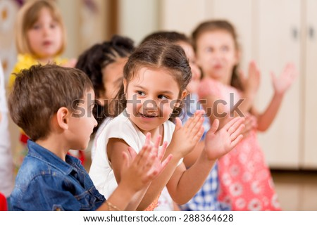 Preschoolers playing in classroom. - stock photo