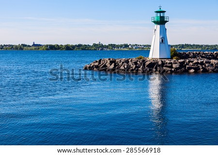 Prescott Heritage Harbour Lighthouse and Ogdensburg, Vermont view accross St. Lawrence River. Prescott, Ontario, Canada. - stock photo