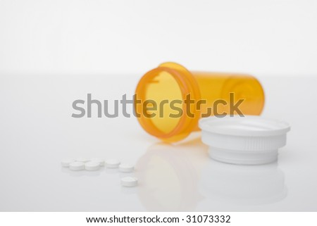 prescription bottle with white pills