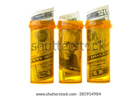 Prescription drug bottles with twenty dollar bills inside, isolated on white