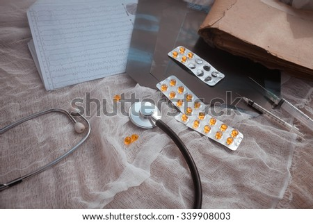 Prescription form lying on table with stethoscope. Medicine concept.