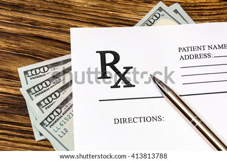 Prescription form with pen and money on the table