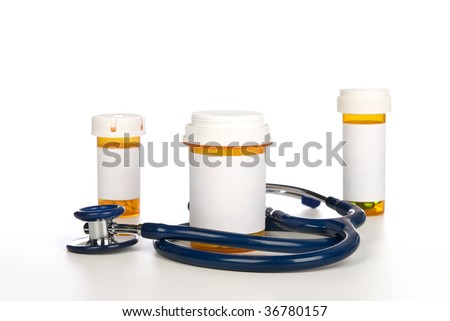 Prescription pill bottles with copy space surrounded by a stethoscope. - stock photo