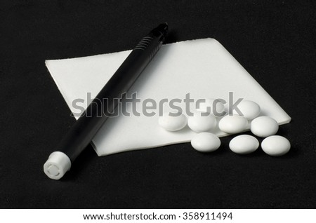 prescription, pills and pen on a dark background - stock photo