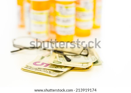 Prescription pills in yellow bottles on a white background.