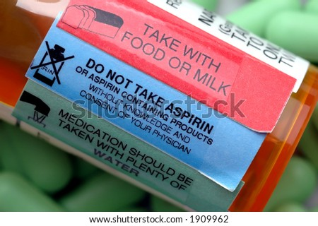 Prescription Warning Labels with pills - stock photo