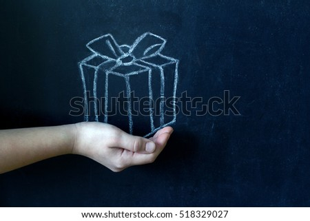 Present and child's hand abstract background concept