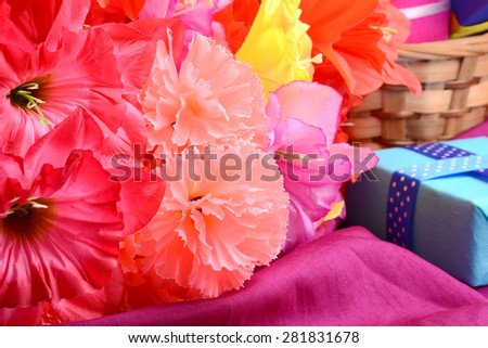 present and flower bouquet on silk