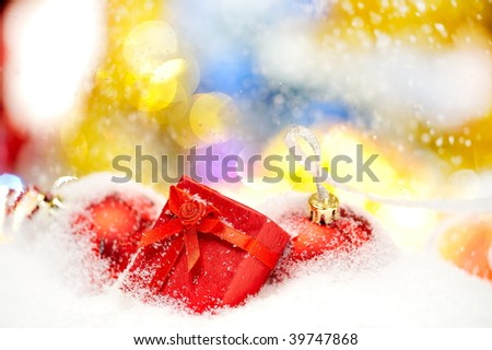 present box and christmas decorations over snow