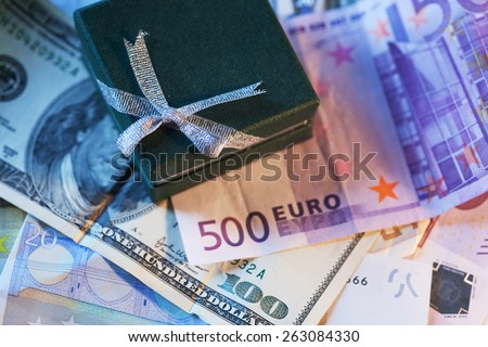 present box and money - dollar and euro, concept photo - stock photo
