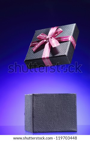 present box on the blue background - stock photo